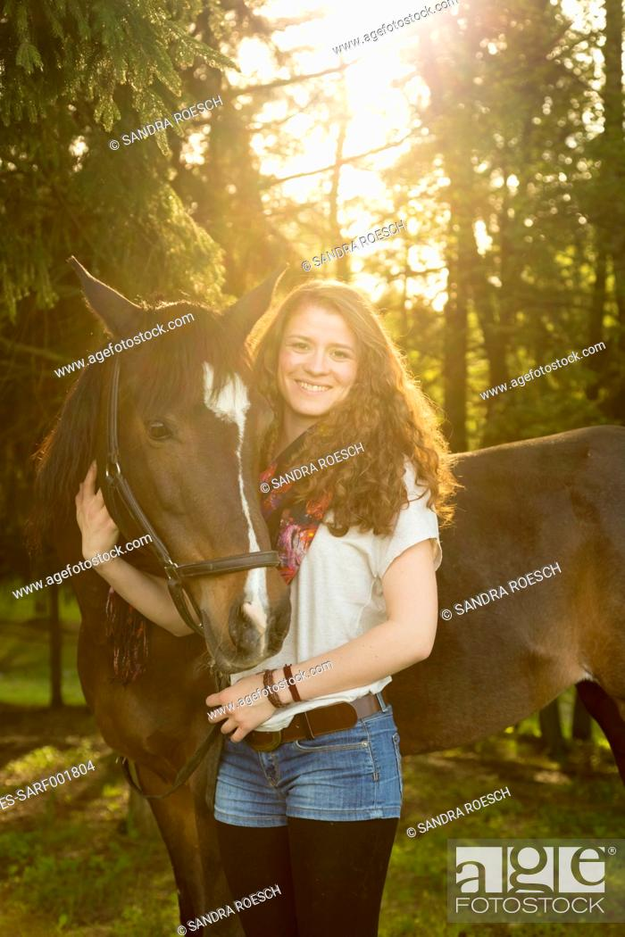 Stock Photo: Smiling young woman with Arabian horse.