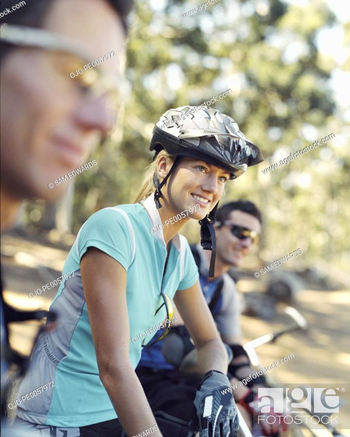Stock Photo: Three mountain bikers outdoors.