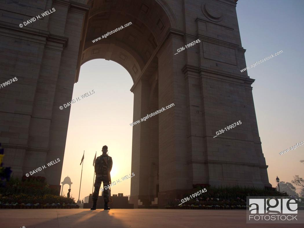 Stock Photo: Security guard standing at India Gate in New Delhi, India.