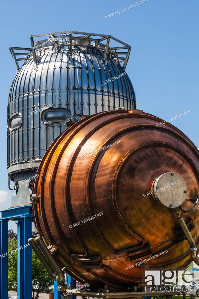 Stock Photo: Bubble chamber and a copper RF accelerating device on display at CERN, Geneva, Switzerland.