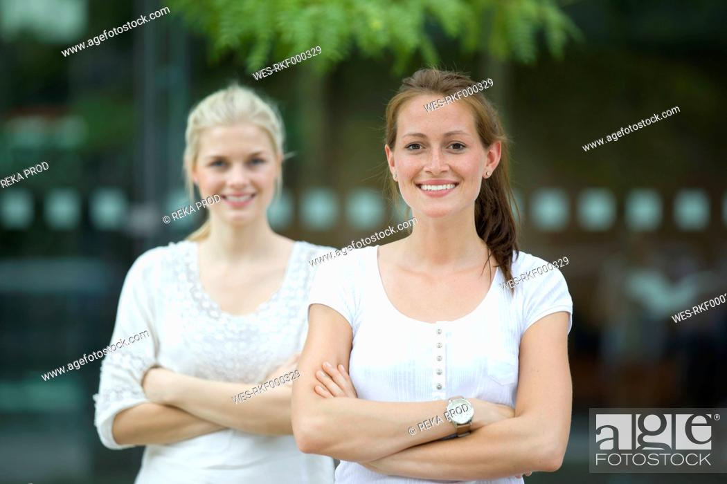 Stock Photo: Germany, North Rhine Westphalia, Cologne, Young students smiling, portrait.