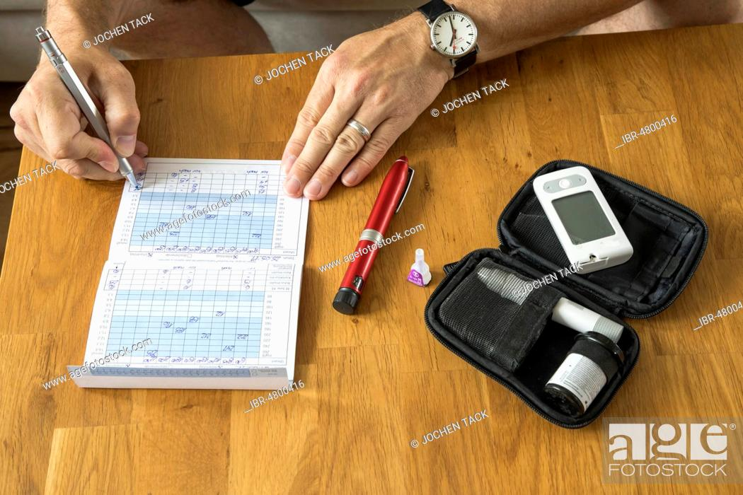 Stock Photo: Diabetics keep his blood sugar diary, record blood sugar values, Germany.