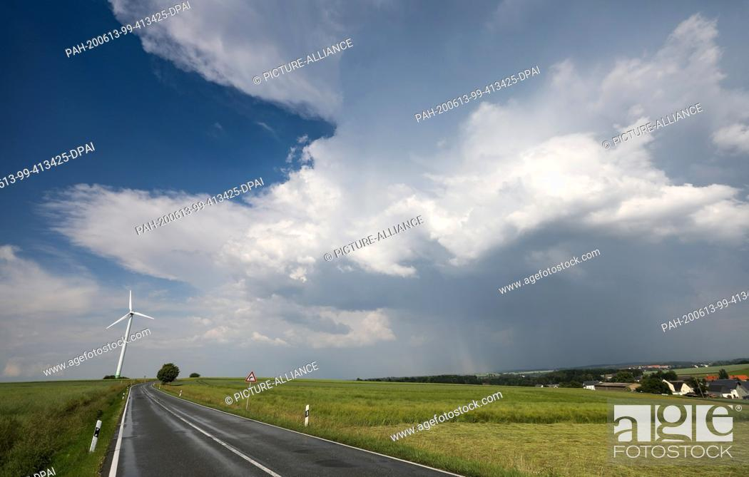 Stock Photo: 13 June 2020, Saxony, Waldenburg: Thunderclouds are moving over the country. In the afternoon heavy thunderstorms are predicted for the region.