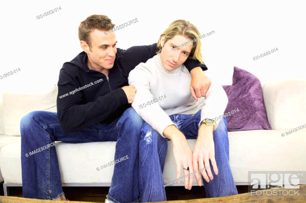 Stock Photo: Man comforting friend on sofa.