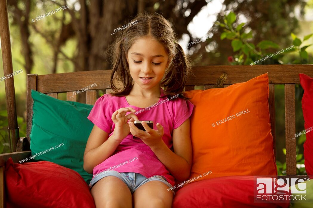 Stock Photo: Little girl with smart phone.