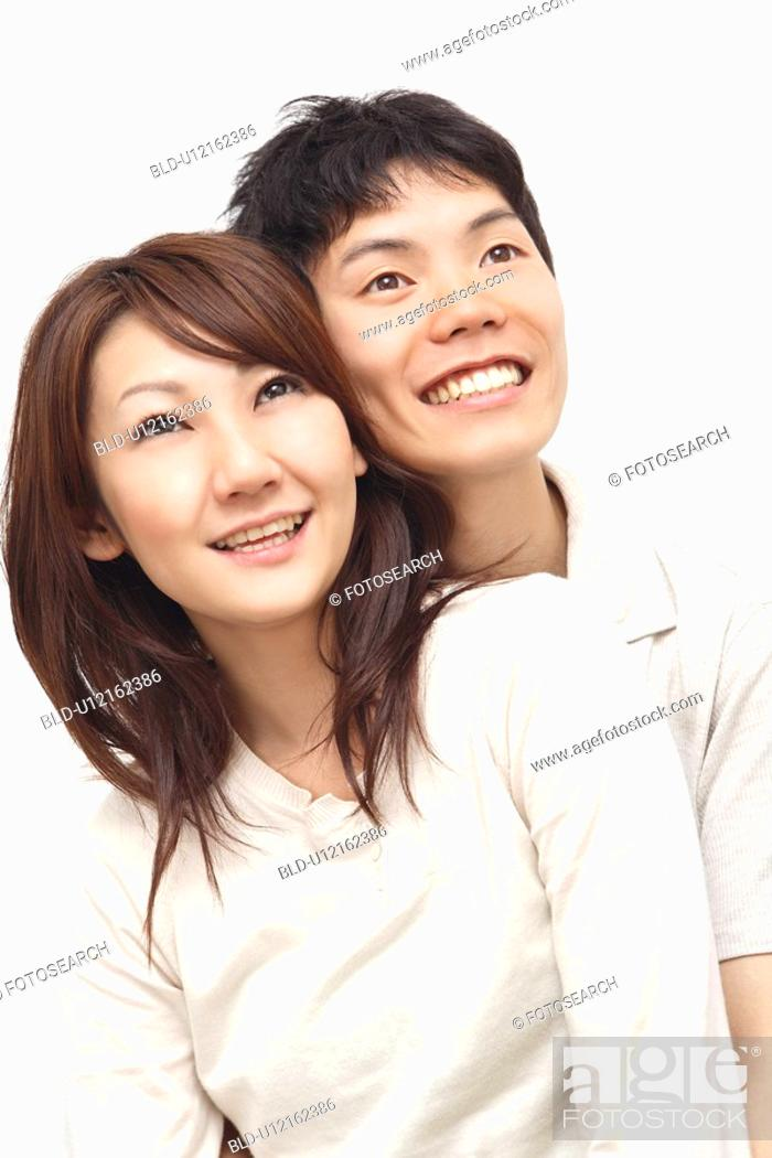 Stock Photo: Couple snuggling up to each other.