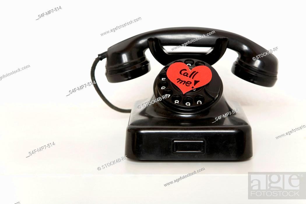 Stock Photo: Heart-shaped slip of paper on old-fashioned telephone.