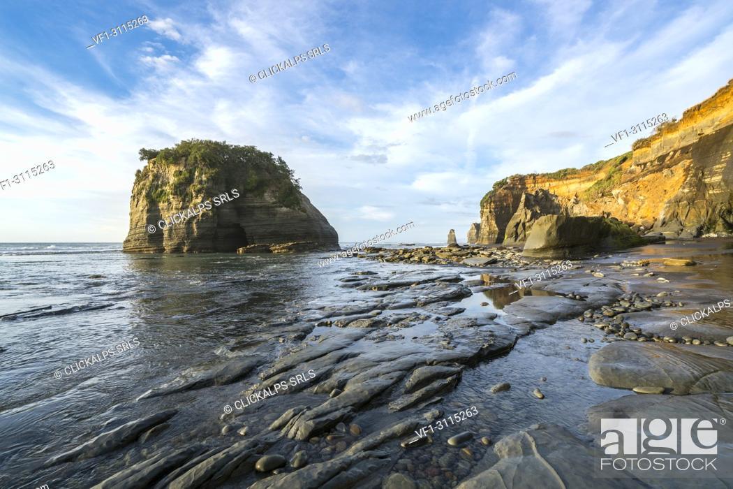 Stock Photo: Rock formations at the Three Sisters. Tongaporutu, New Plymouth district. Taranaki region, North Island, New Zealand.