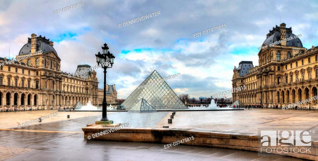 Stock Photo: Beautiful view of the Louvre in Paris on a cloudy winter day.