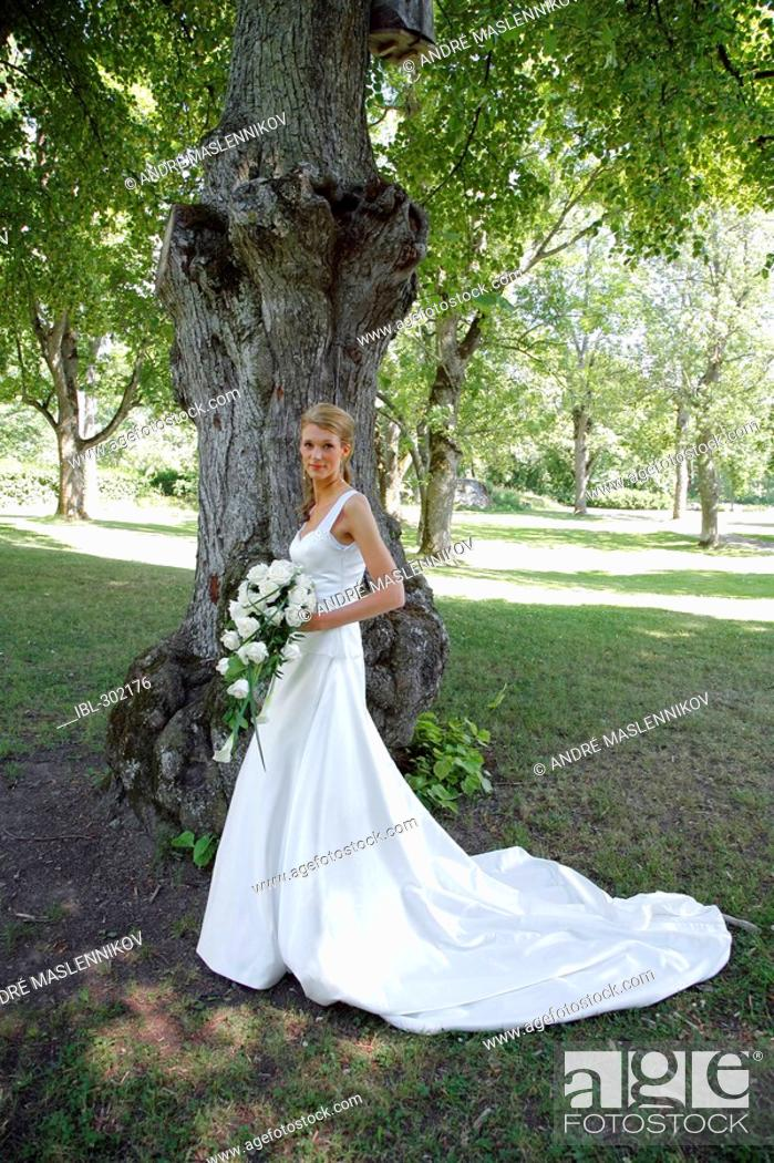 Stock Photo: Bride posing in the park.