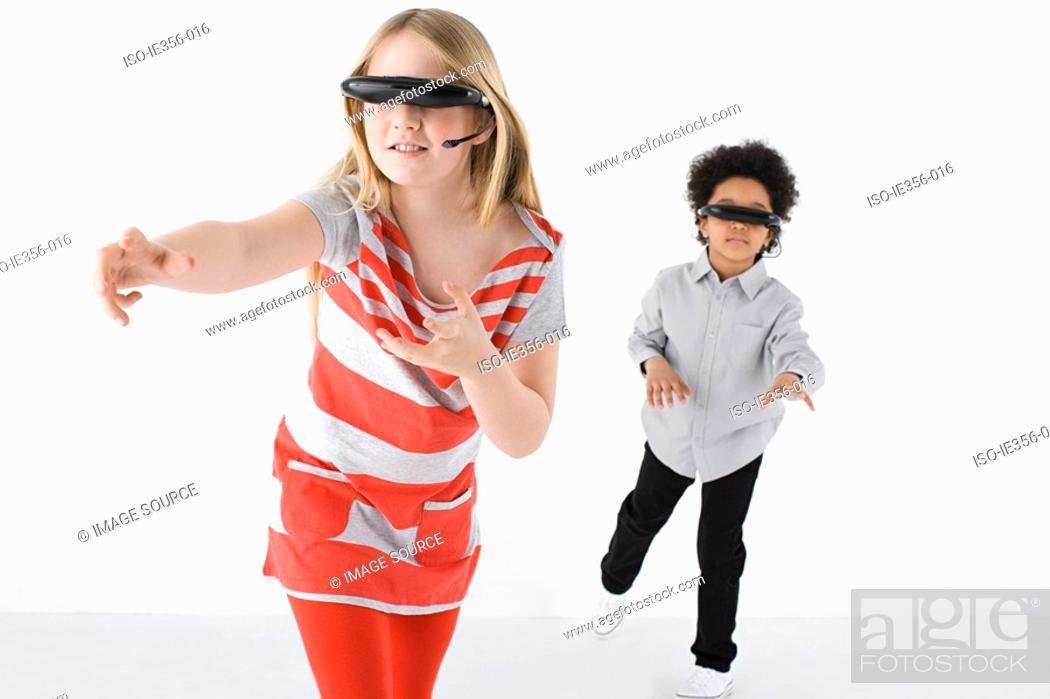 Stock Photo: Kids wearing virtual reality headsets.