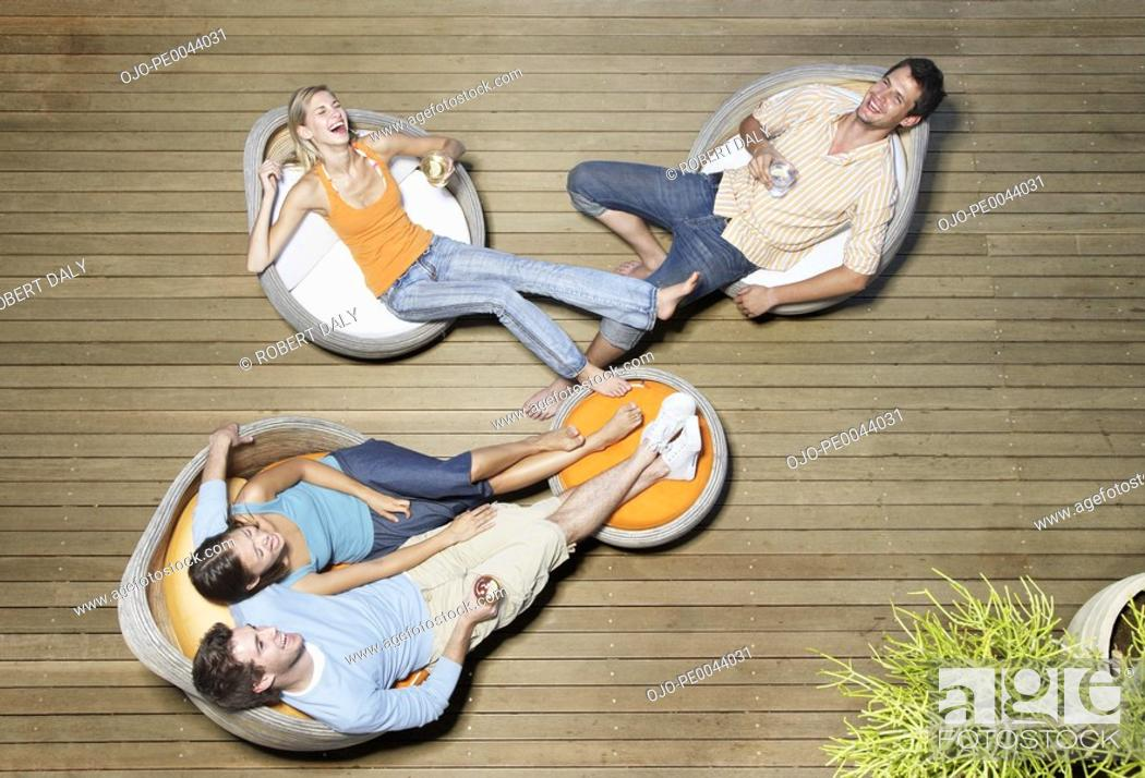 Stock Photo: Friends hanging out on a deck.