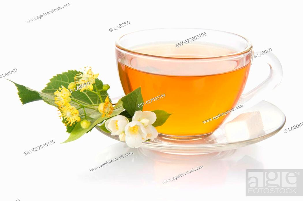 Stock Photo: Cup of tea with a saucer and the jasmine and linden flower, isolated on white.