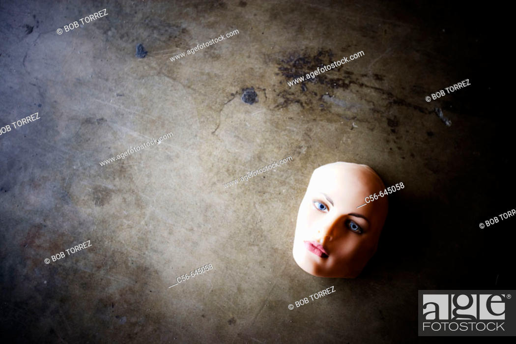 Stock Photo: Mannequin face on concrete floor.