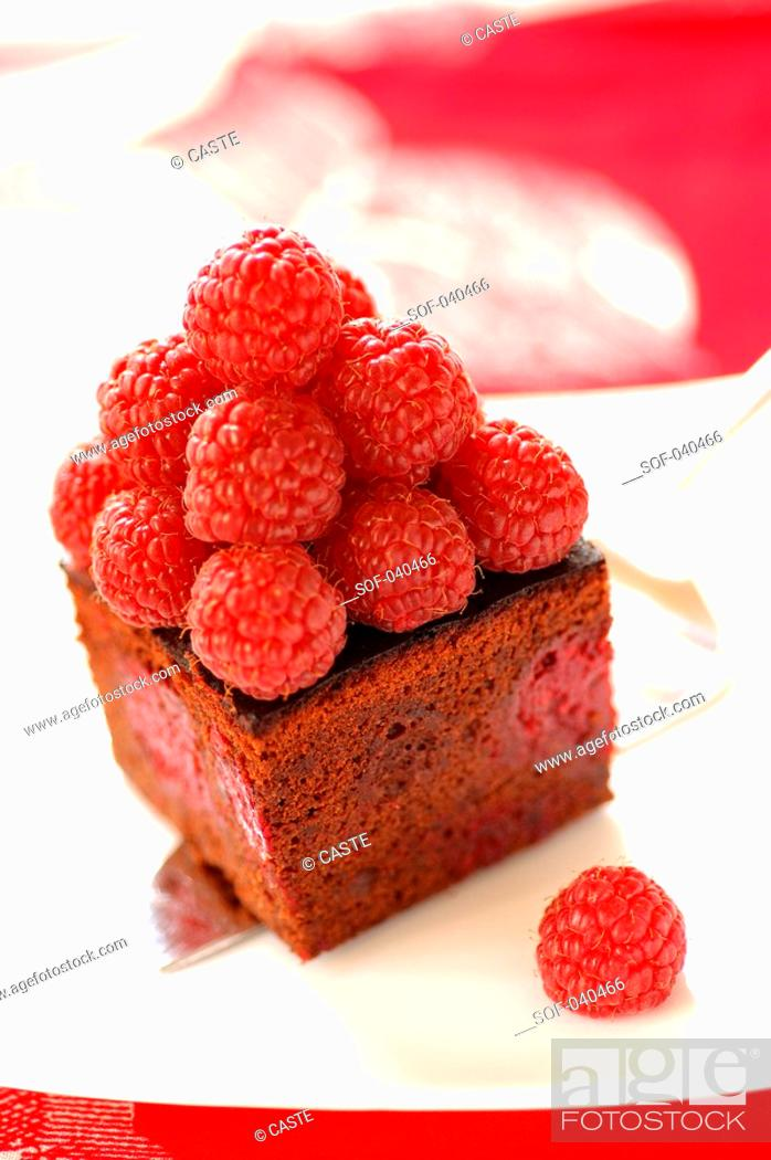 Stock Photo: Dark chocolate cake with raspberries.