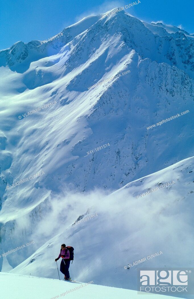 Stock Photo: One man on ski walking uphill in remote part of Otztal Alps, Austria.