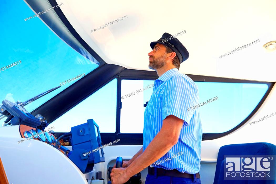 Photo de stock: Captain cap sailor boating modern yacht boat indoor with beard.