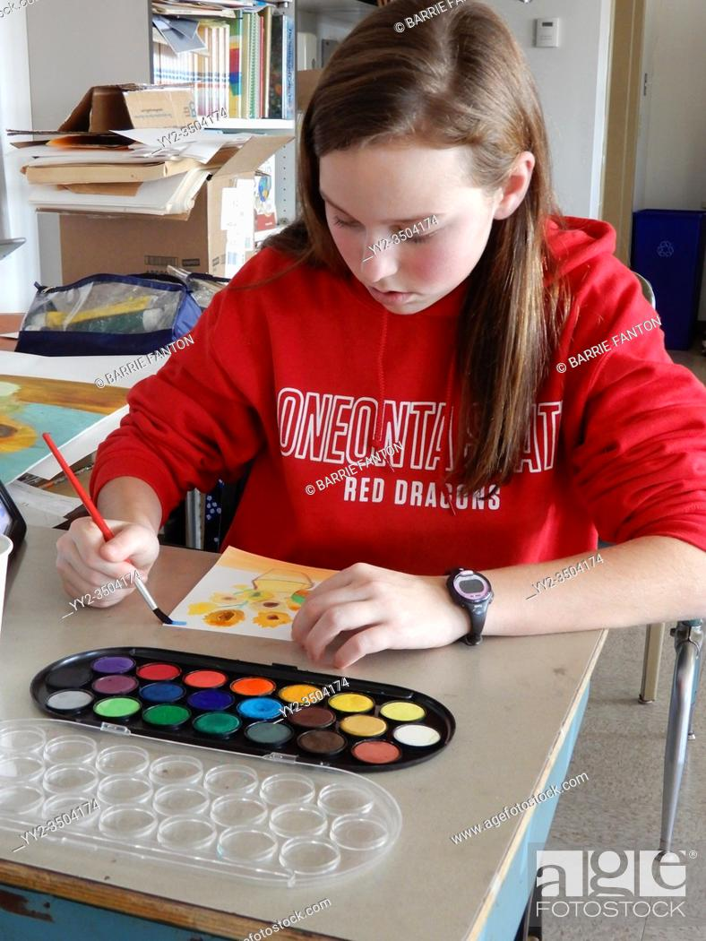 Stock Photo: Middle School Girl Working on Art Project, Wellsville, New York.
