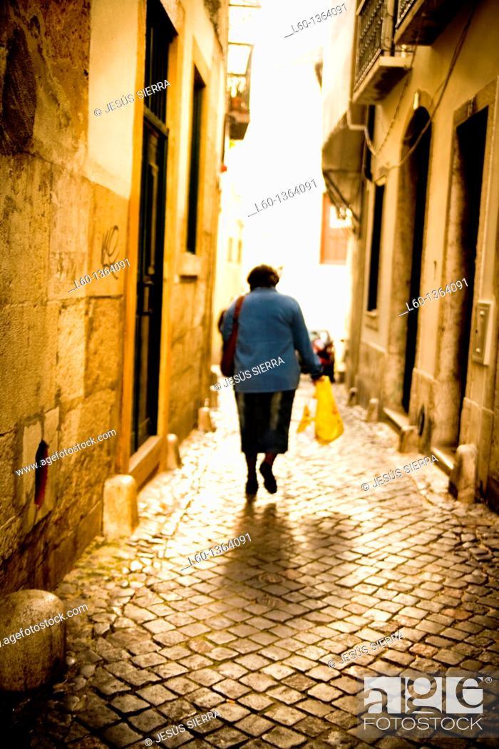 Stock Photo: Woman in Alfama, Lisbon, Portugal.