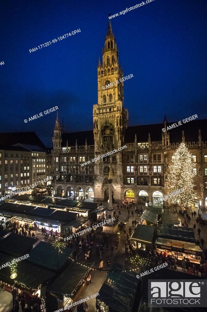 Stock Photo: The view onto the traditional Christmas market at the Marienplatz in Munich, Germany, 28 November 2017. The Christmas markets starts on 27 November 2017 and.