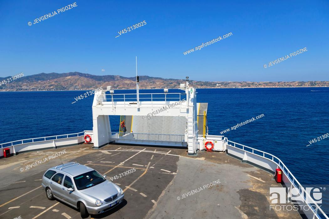 Stock Photo: Ferry boat heading towards Messina Tremestieri ferry port of Sicily from Reggio di Calabria ferry port, Strait of Messina, Calabria, Southern Italy, Italy.