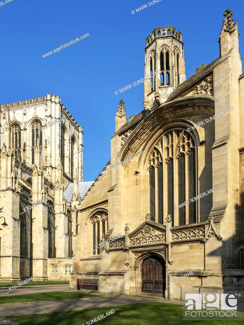 Stock Photo: York Minster and St Michael le Belfry Church lit by spring sunshine York Yorkshire England.