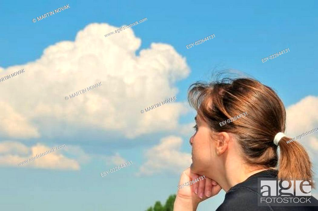 Stock Photo: Head in sky - dreaming young woman.