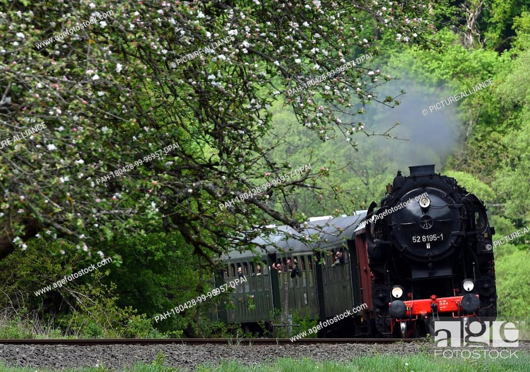 Stock Photo: dpatop - 27 April 2018, Germany, Trier: A steam train travelling with guests on the route from Gerolstein to Trier. From the 28 April to the 01 May 2018.