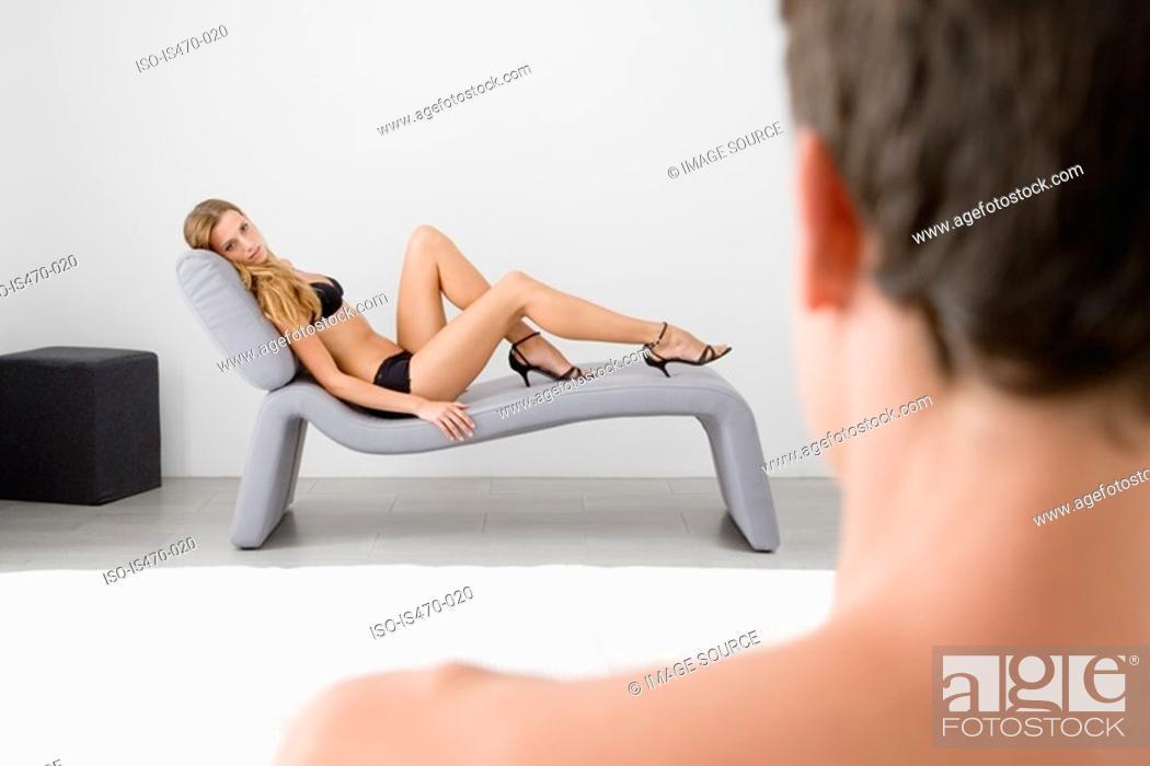 Stock Photo: Man looking at provocative woman.