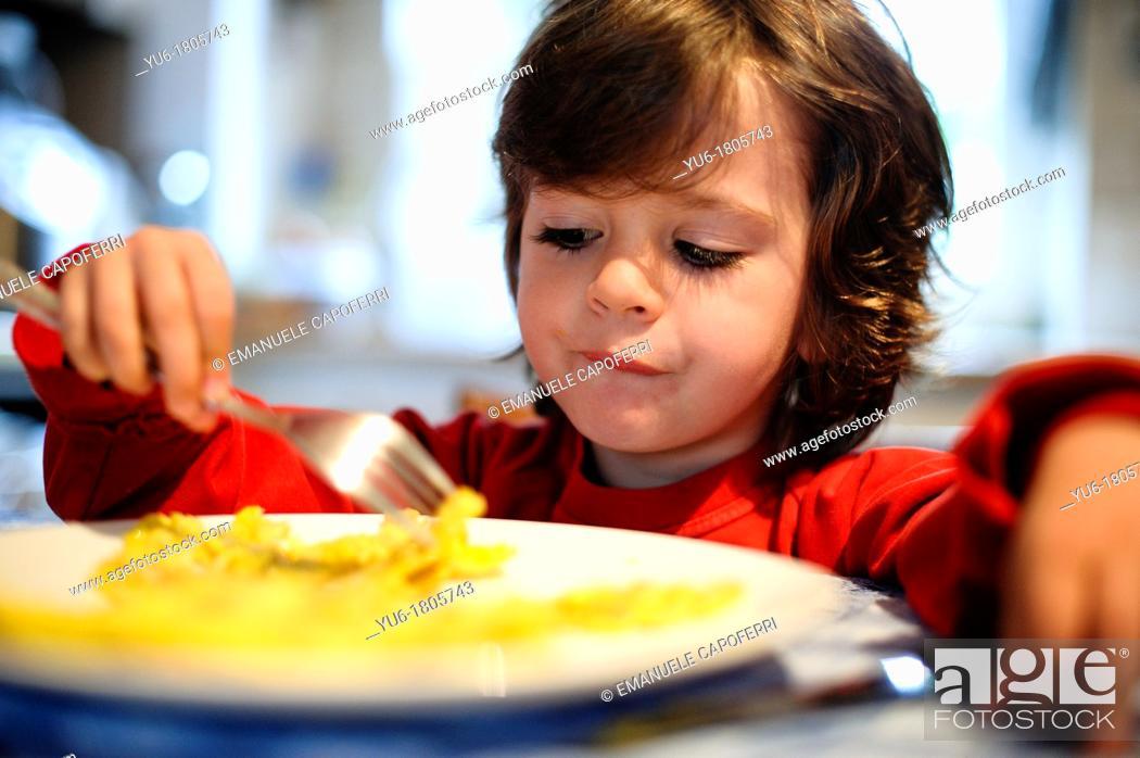 Stock Photo: Child eat pancake breakfast.