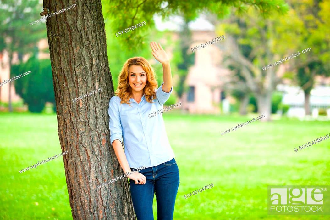 Stock Photo: Beautiful Young Woman Relaxing Outdoors. Meadow. Beauty Girl Enjoying Nature.
