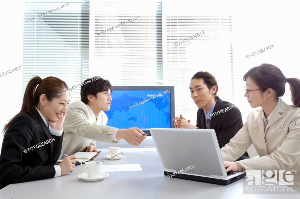 Stock Photo: Business people during conference.