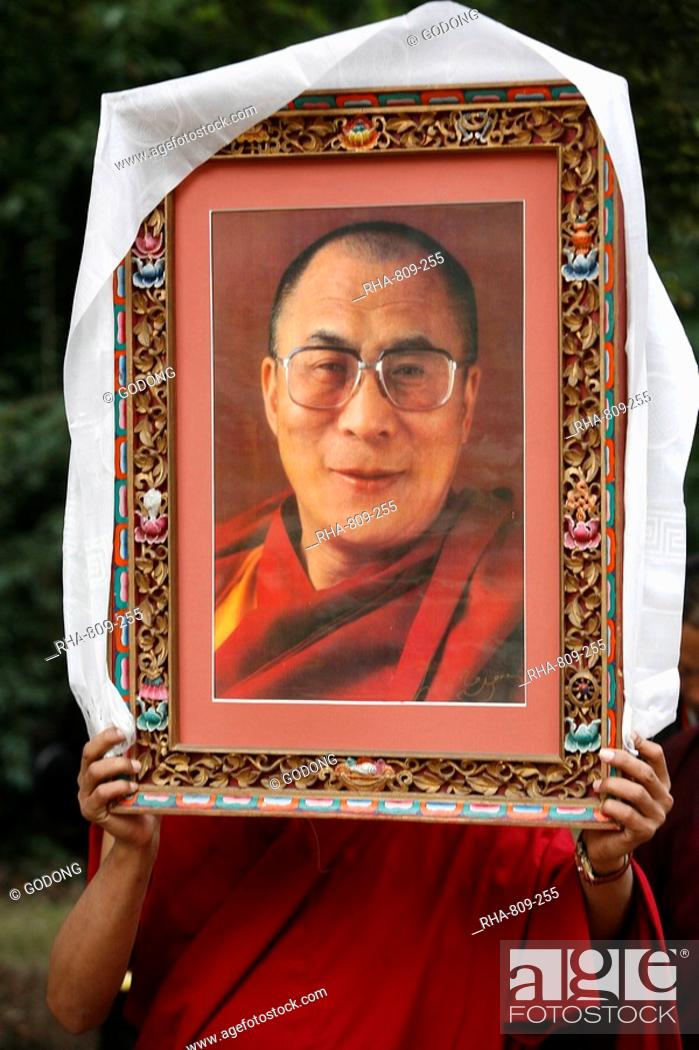 Buddhist Holding A Picture Of The Dalai Lama Paris Ile De