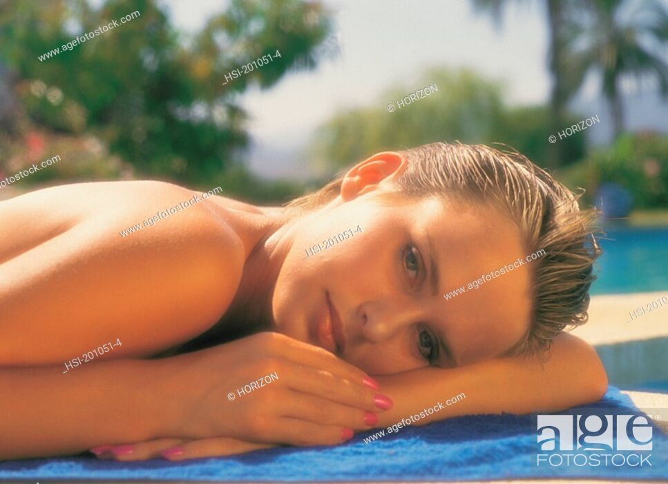 Stock Photo: Close-up of woman relaxing on mat.