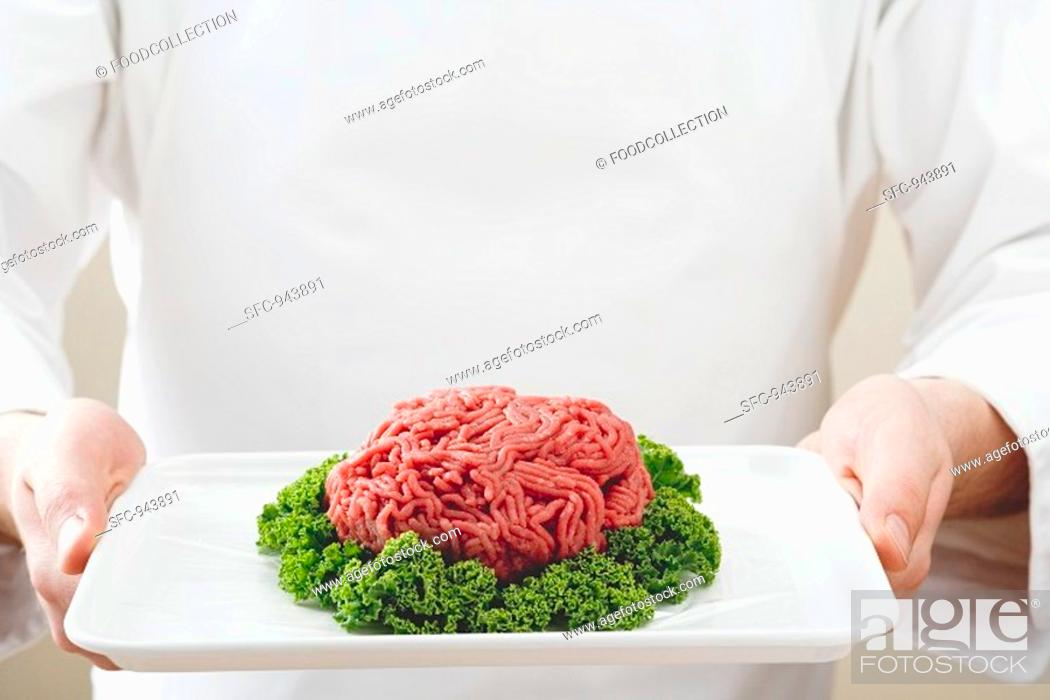 Stock Photo: Mince with parsley on a platter.