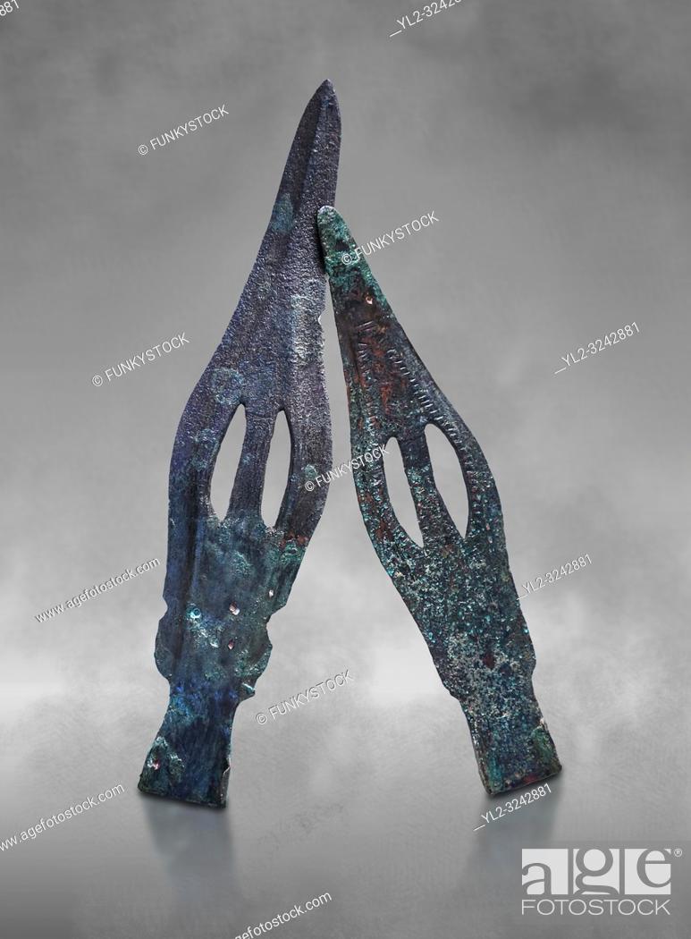 Stock Photo: Hittite bronze spear heads. Hittite Period 1650 - 1450 BC, Ortakoy Sapinuva . Çorum Archaeological Museum, Corum, Turkey. Against a grey bacground.