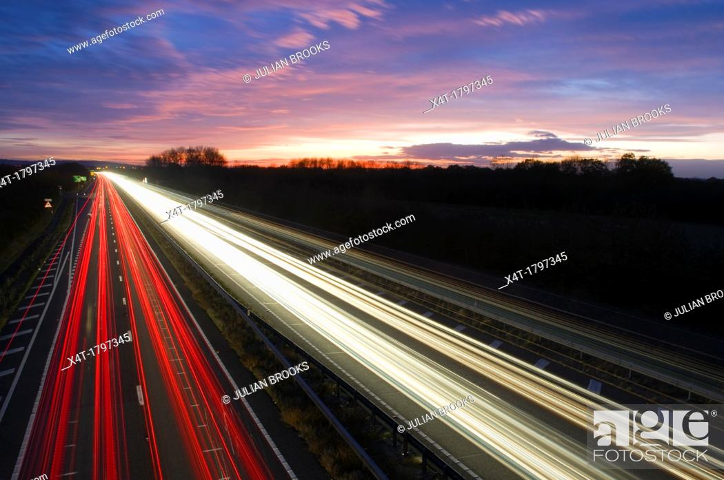 Stock Photo: ligh trails at night on a busy main road.