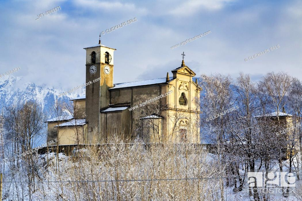 Stock Photo: Old church of Sant'Andrea surrounded by snow, Civo, Costiera dei Cech, Sondrio province, Valtellina, Lombardy, Italy.