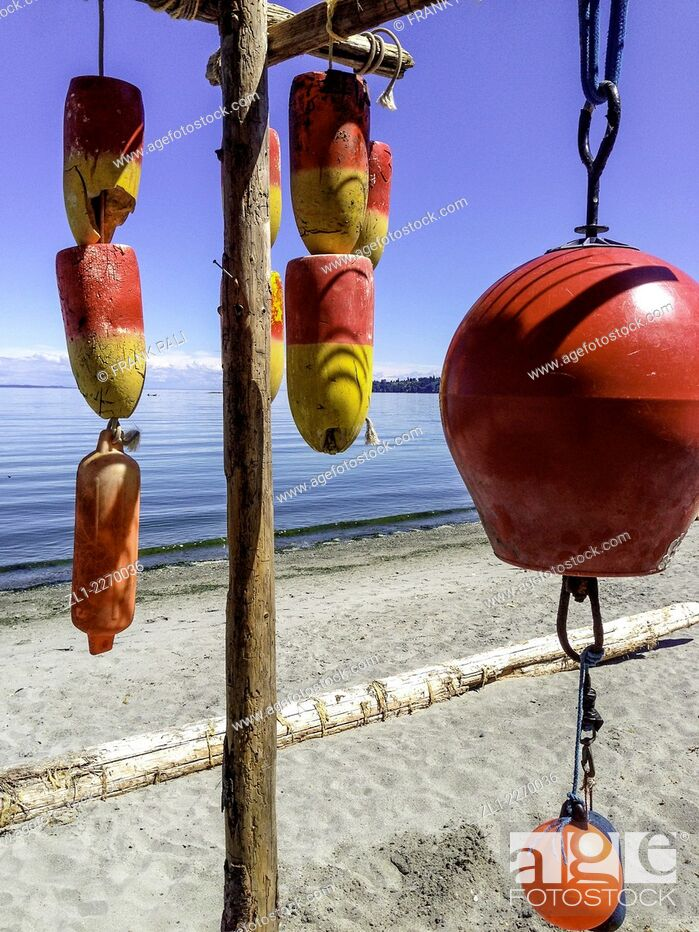 Stock Photo: Colourful floats hanging on beach in Victoria British Columbia.