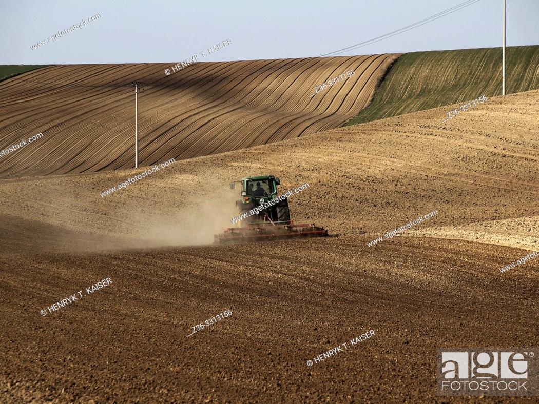 Stock Photo: Tractor plowing in Lasser Poland near Slomniki.