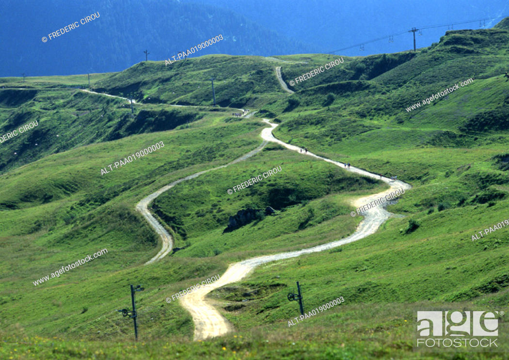 Stock Photo: France, Savoie, road winding through hilly area.