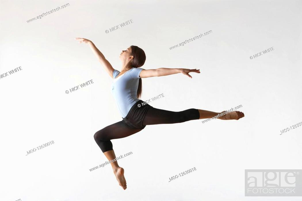 Stock Photo: Ballerina Leaping in Mid-air.