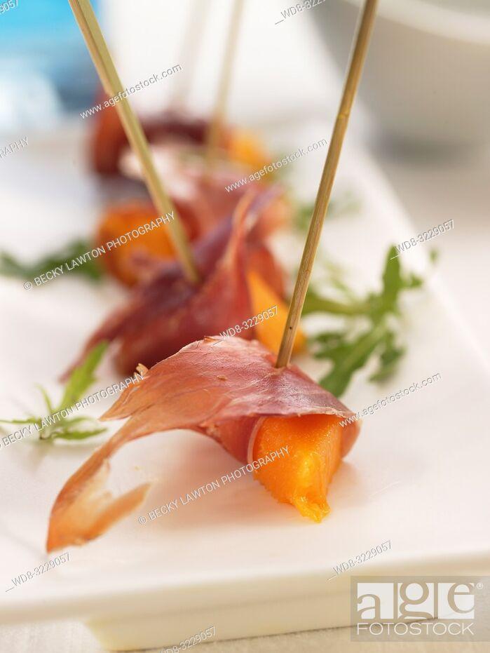 Stock Photo: Pincho de jamon serrano y melon.