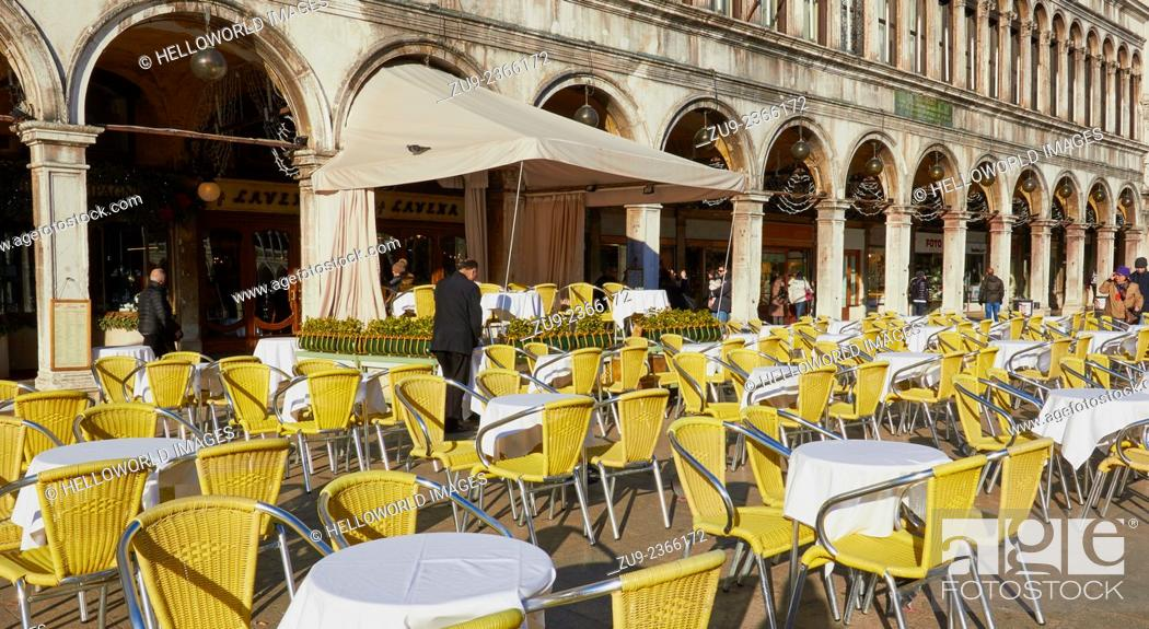 Stock Photo: Alfresco cafe tables and chairs in winter sun alongside elegant arched colonnade, Piazza San Marco, Venice, Veneto, Italy, Europe.
