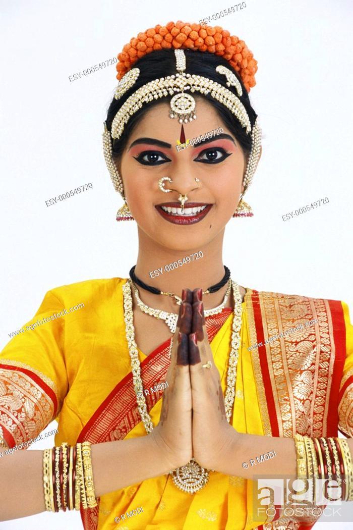 Dancer performing bharatnatyam showing emotion welcome