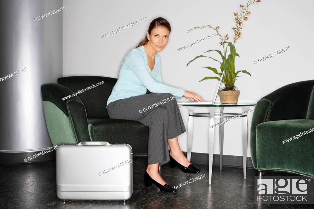 Stock Photo: Portrait of a businesswoman using a laptop.