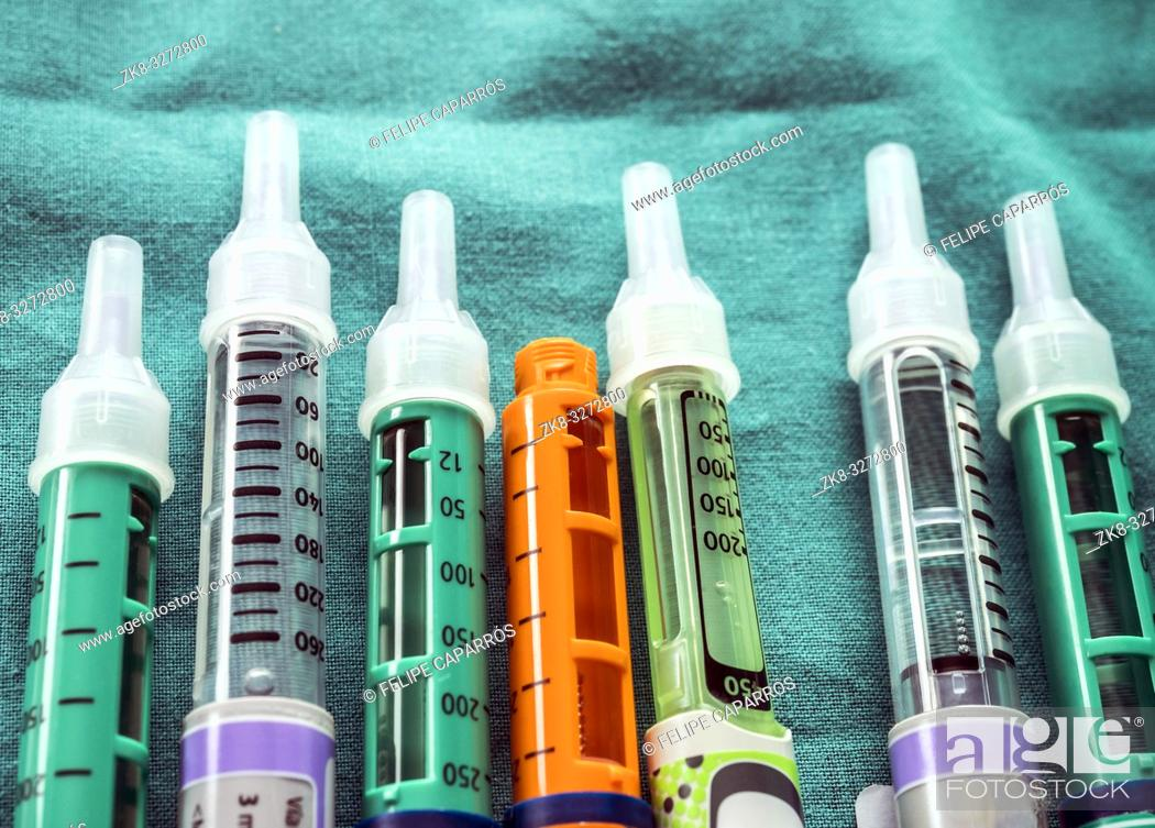 Stock Photo: Several Injectors of insulin, conceptual image, composition horizontal.