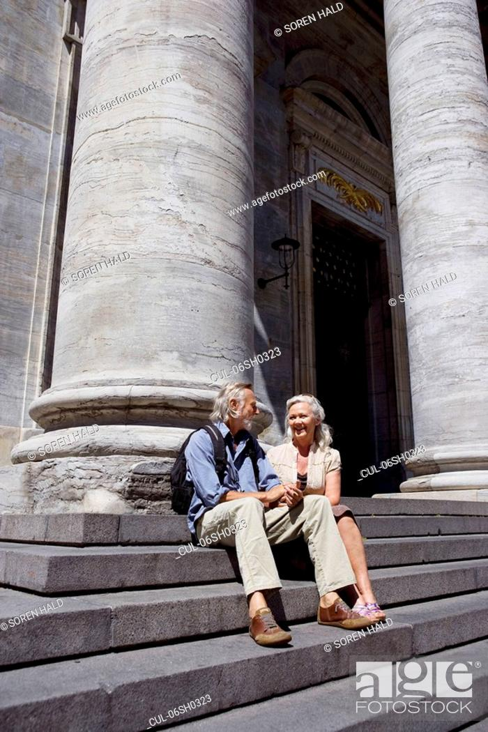 Stock Photo: Couple resting on stairs.