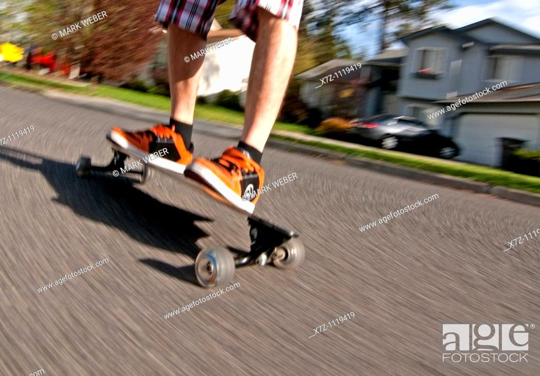 Stock Photo: Man riding the Longboard in Spokane Washington.