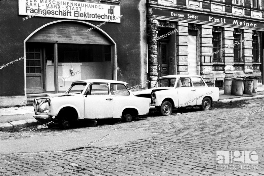 Stock Photo: Karl Marx Stadt, East Germany. Abandoned and partly demolished Trabi's, parked alongside a road in the former DDR town of Karl Marx Stadt, now Chemnitz.
